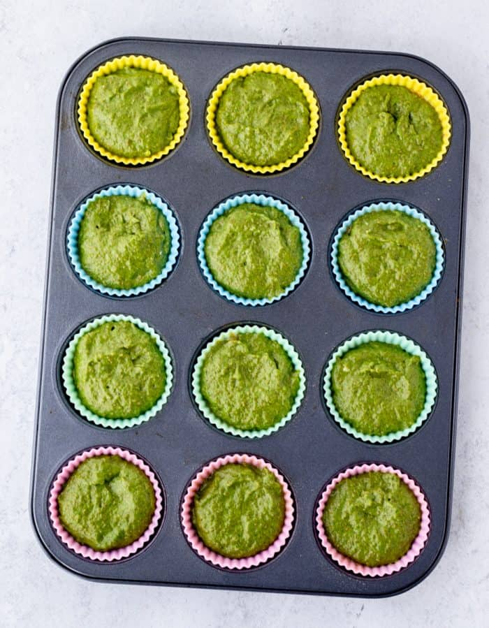 Muffin molds filled with the batter.