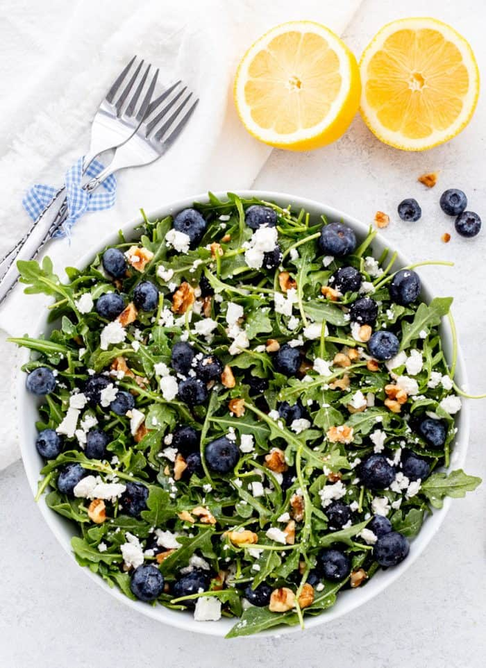 Overhead shot of the blueberry walnut salad in a large serving bowl.