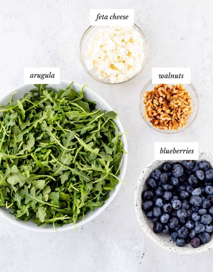 Ingredients to make the salad in bowls.