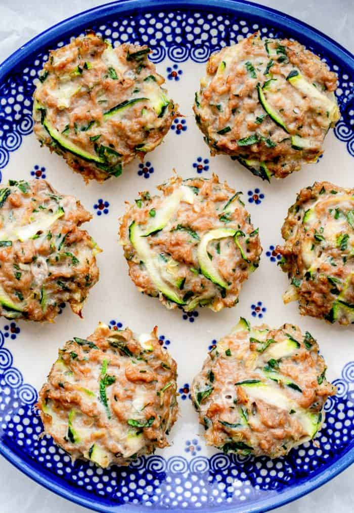Seven chicken muffins on a blue plate.