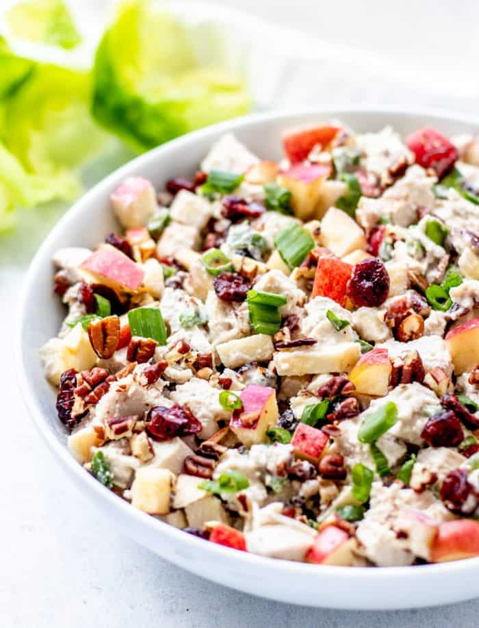 Apple, cranberry and walnut chicken salad in a serving bowl.