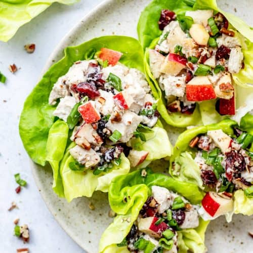 Cranberry chicken salad served in four lettuce leaves.