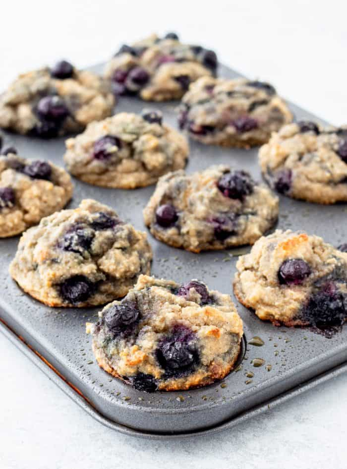Baked mini blueberry muffins in muffin tin