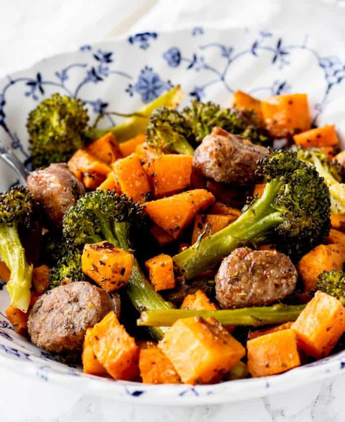 A bowl of sausage and vegetables ready to eat.