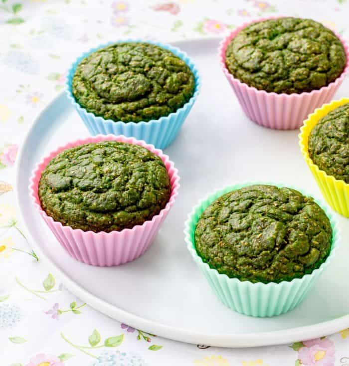 muffins in colourful silicone baking cups on white plate
