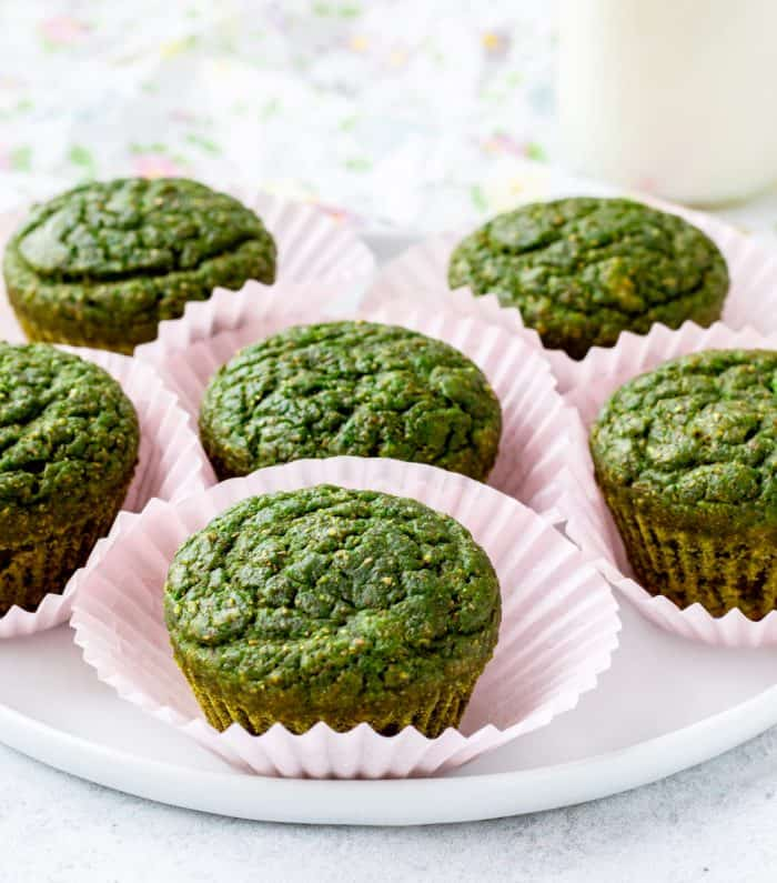 spinach muffins in pink paper liners on plate