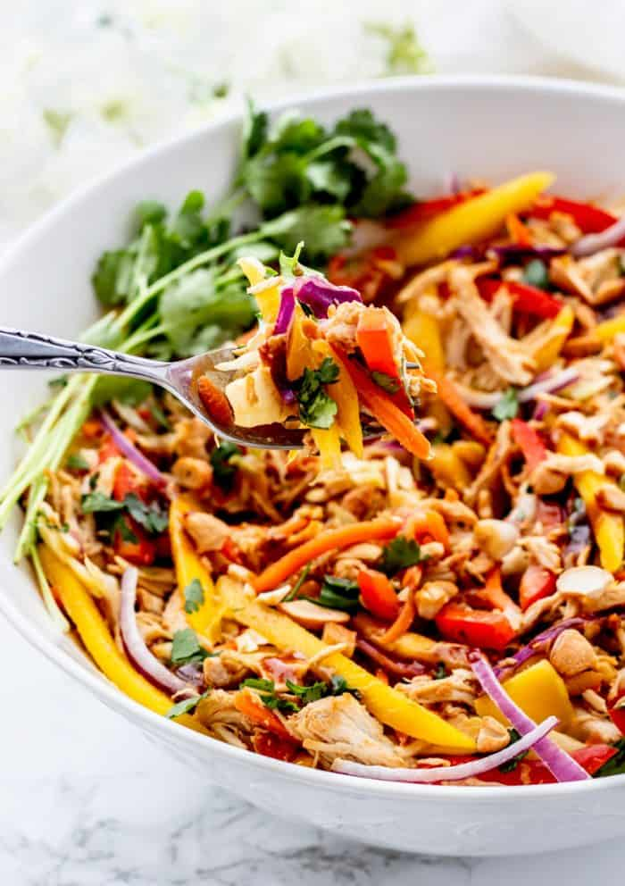 The Thai chicken salad being eaten with a fork.