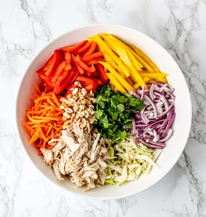 The salad ingredients in a large serving bowl.