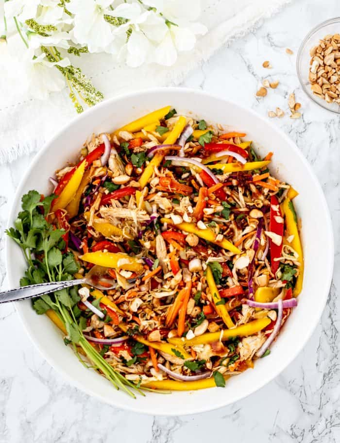 Chicken and mango Thai salad in a large serving bowl.