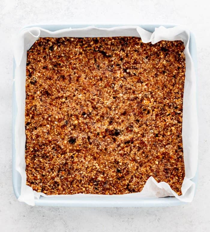 The nut and lemon mixture pressed into a baking tin.
