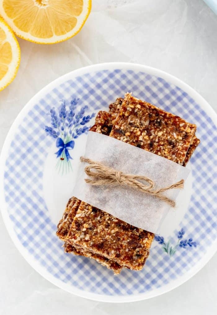The vegan lemon bars wrapped in a strip of parchment and tied with string.
