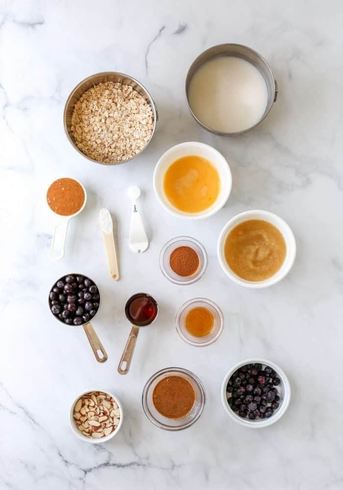 The ingredients to make the recipe on a marble surface.