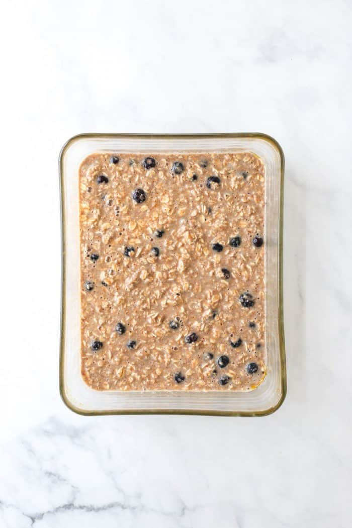 The mixed oatmeal in a glass baking dish before being baked.