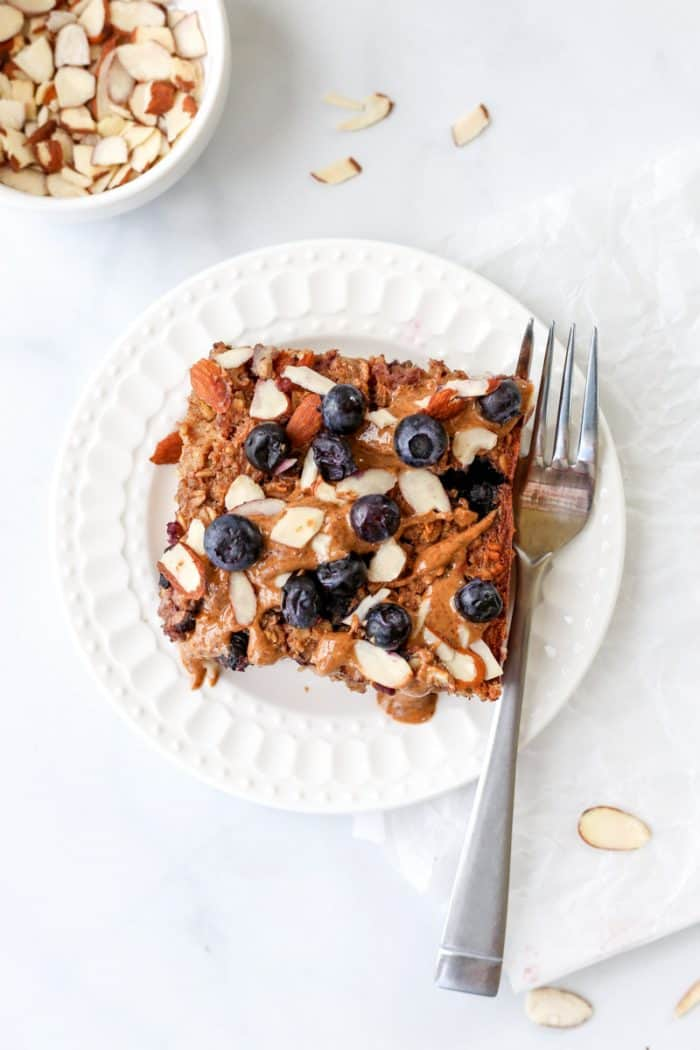 Overhead shot of a square of the blueberry oatmeal on a plate with a fork.