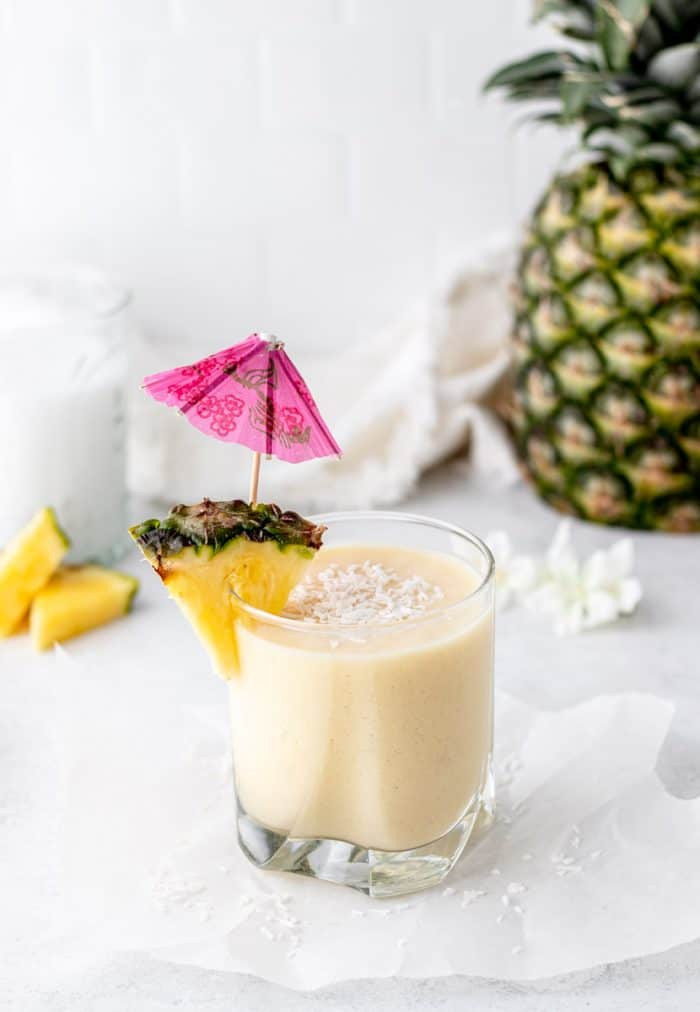 The pina colada smoothie sprinkled with coconut flakes.