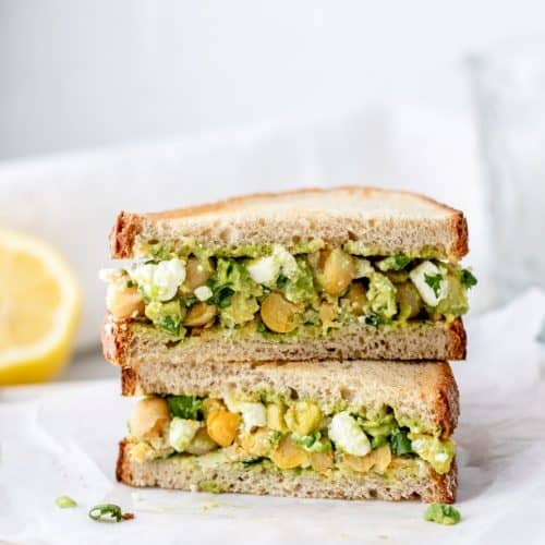 Chickpea and feta salad in between two slices of bread.