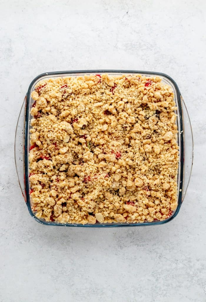 The crumble topping added to the top of the fruit filling.