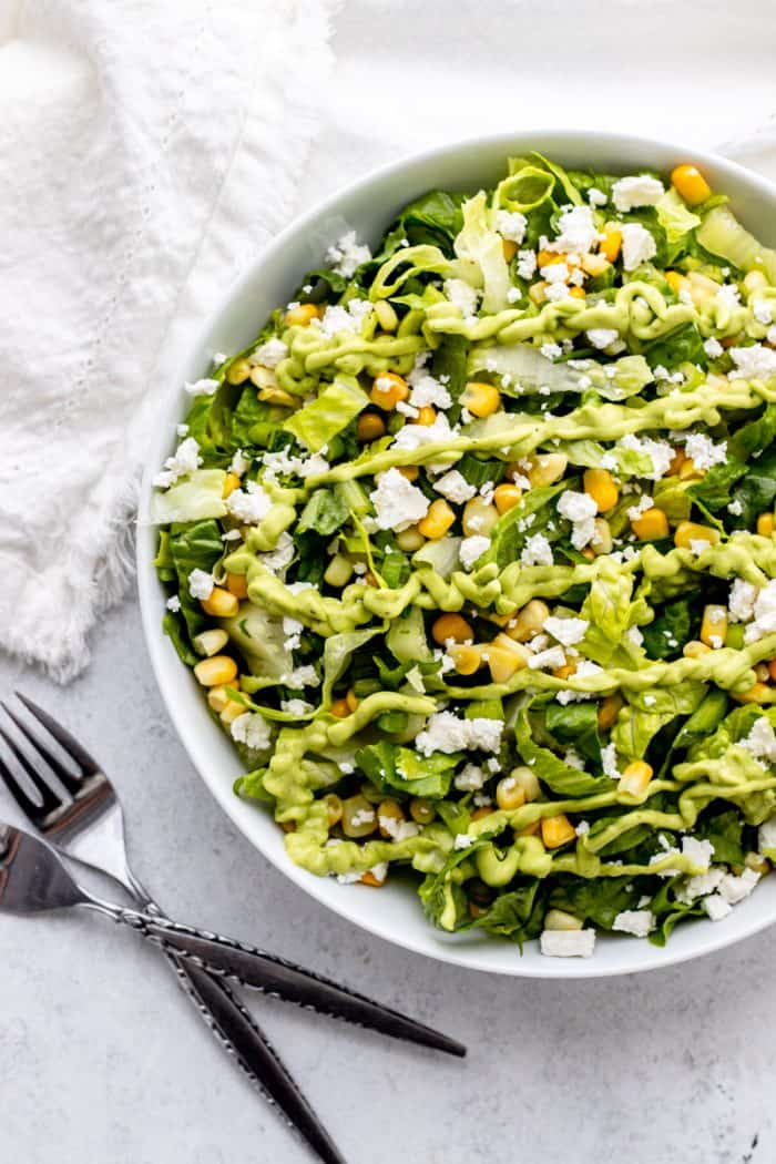 Green goddess dressing drizzled over a salad.