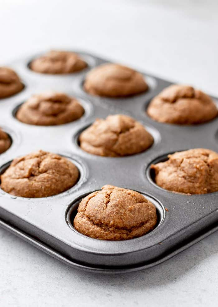 The baked almond butter muffins in a tin.