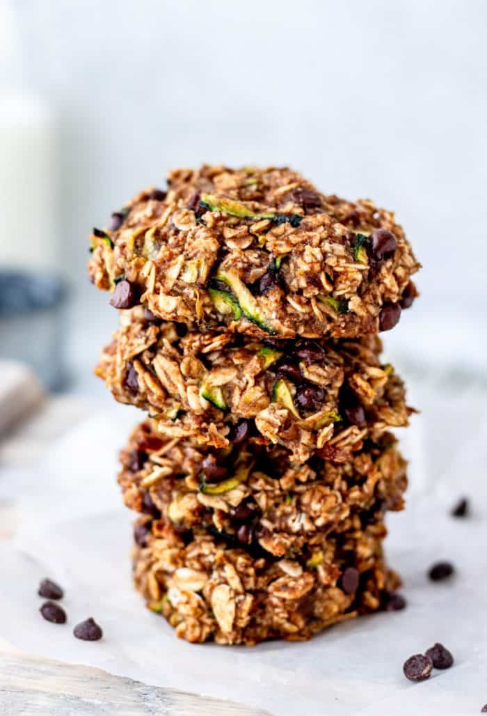 Four oatmeal zucchini cookies stacked on top of each other.