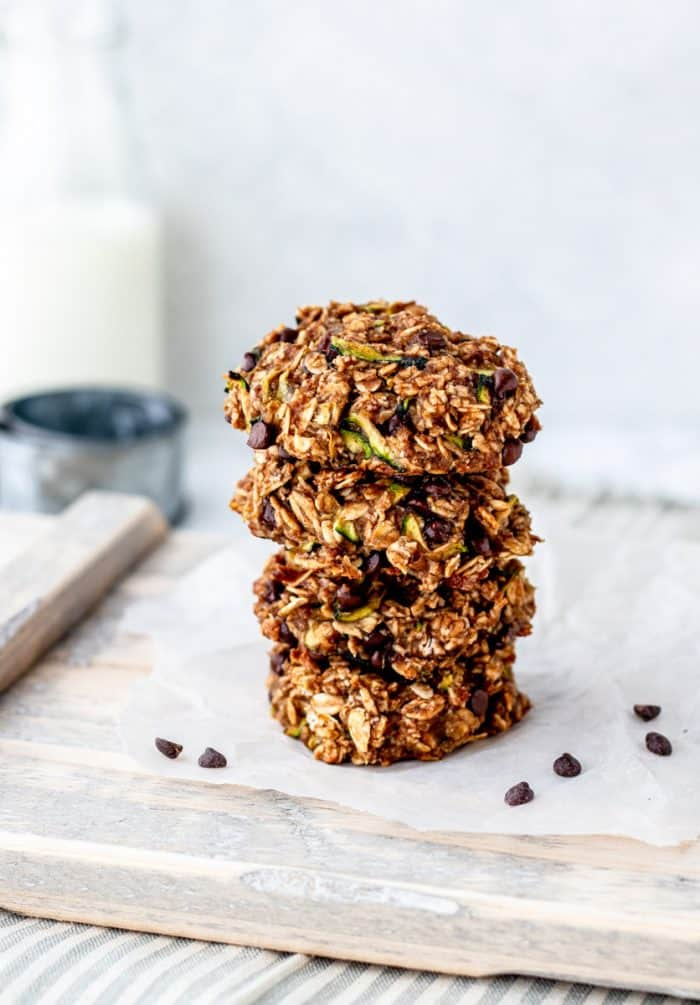 Four zucchini chocolate chip cookies stacked on top of each other.