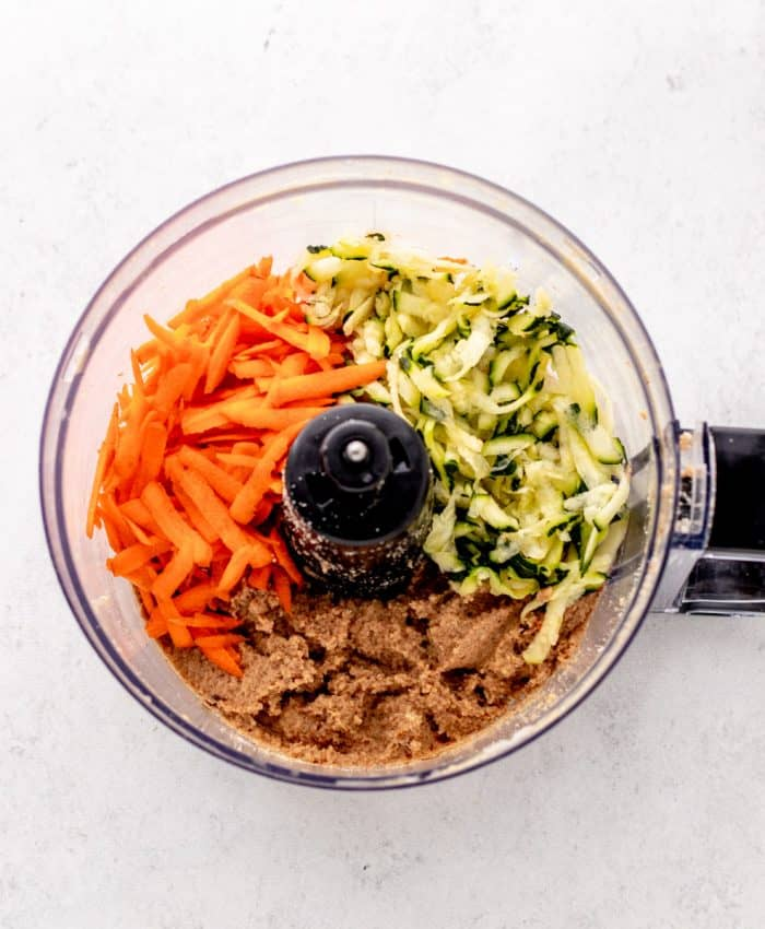 Shredded carrot and zucchini added to the food processor.