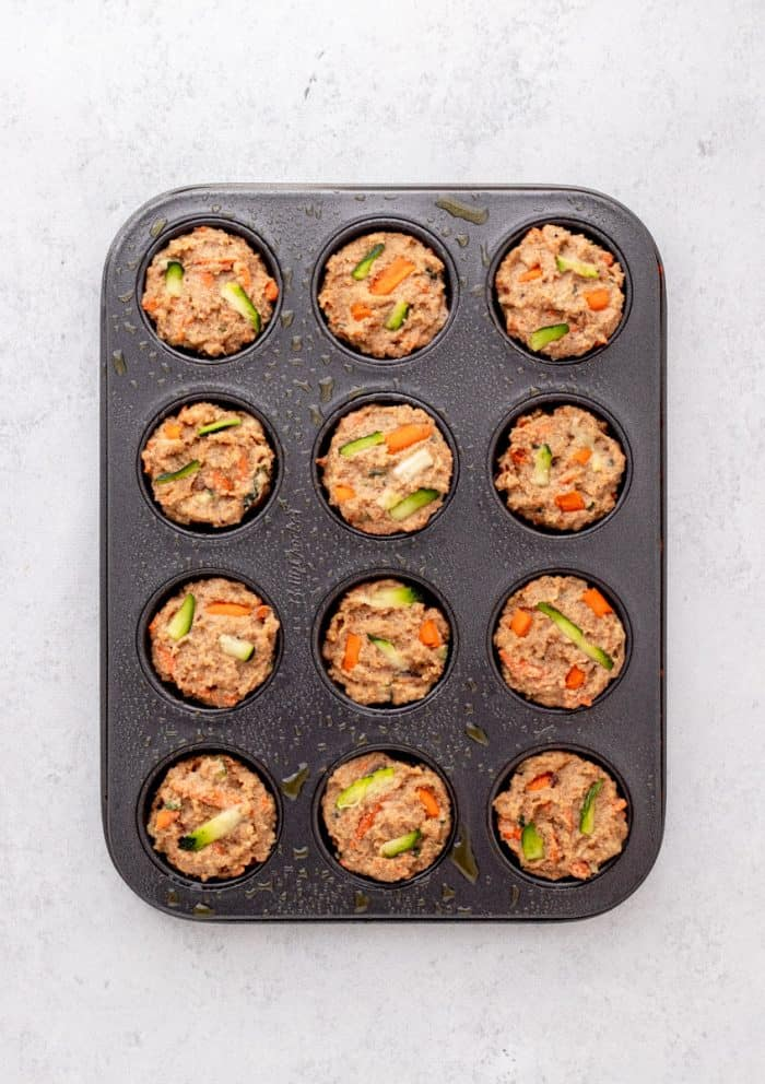 The batter placed into a muffin tin.