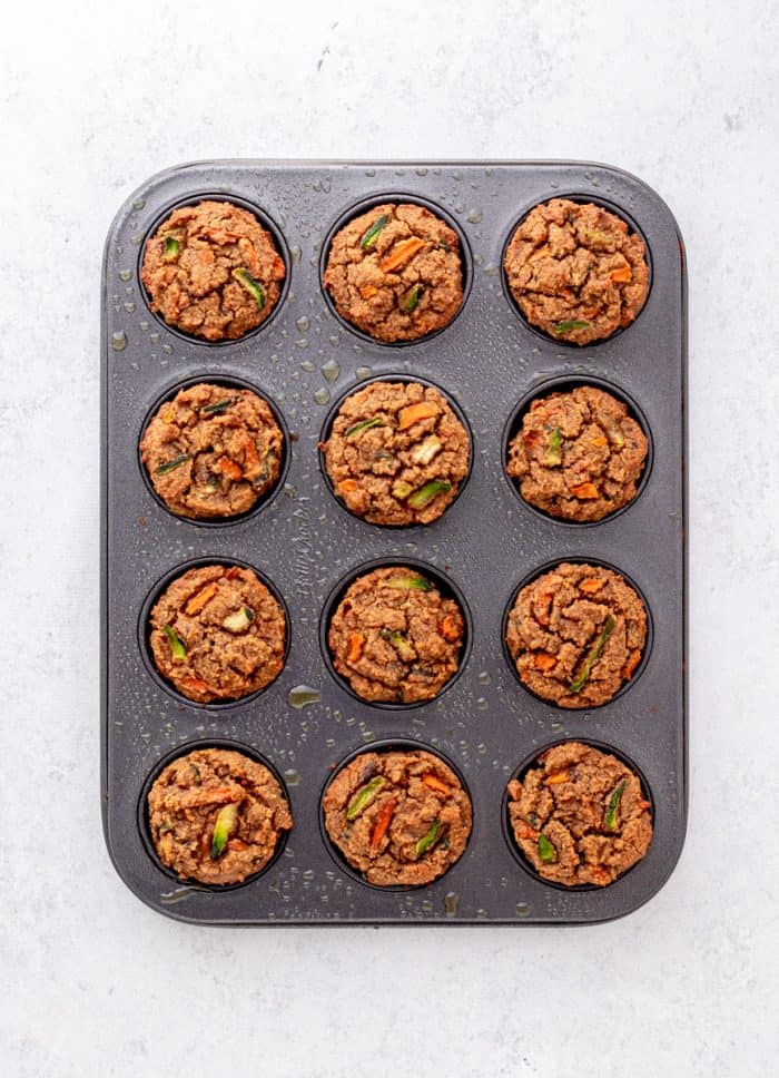 Baked carrot zucchini muffins in a tin.