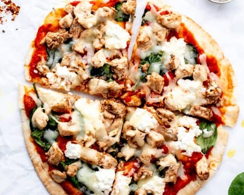 A pita pizza cut into four pieces.