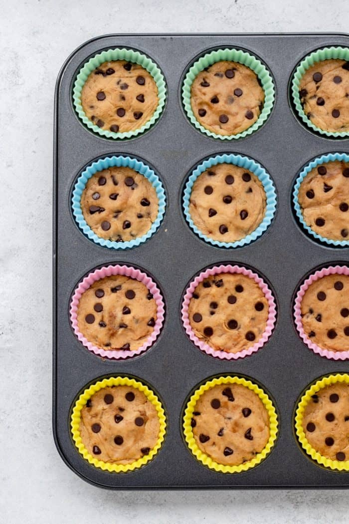 The cookie dough batter in silicon baking cups.
