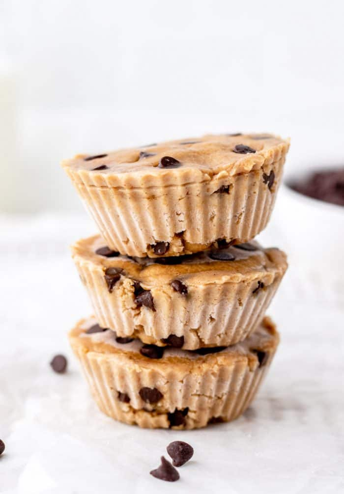 Three chocolate chip cookie dough bites stacked on top of each other.