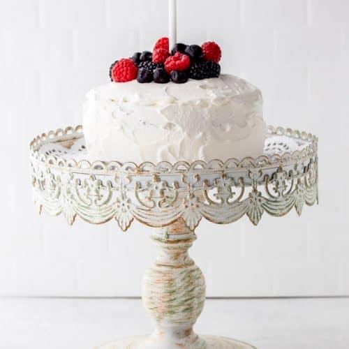 A birthday smash cake on a cake stand.