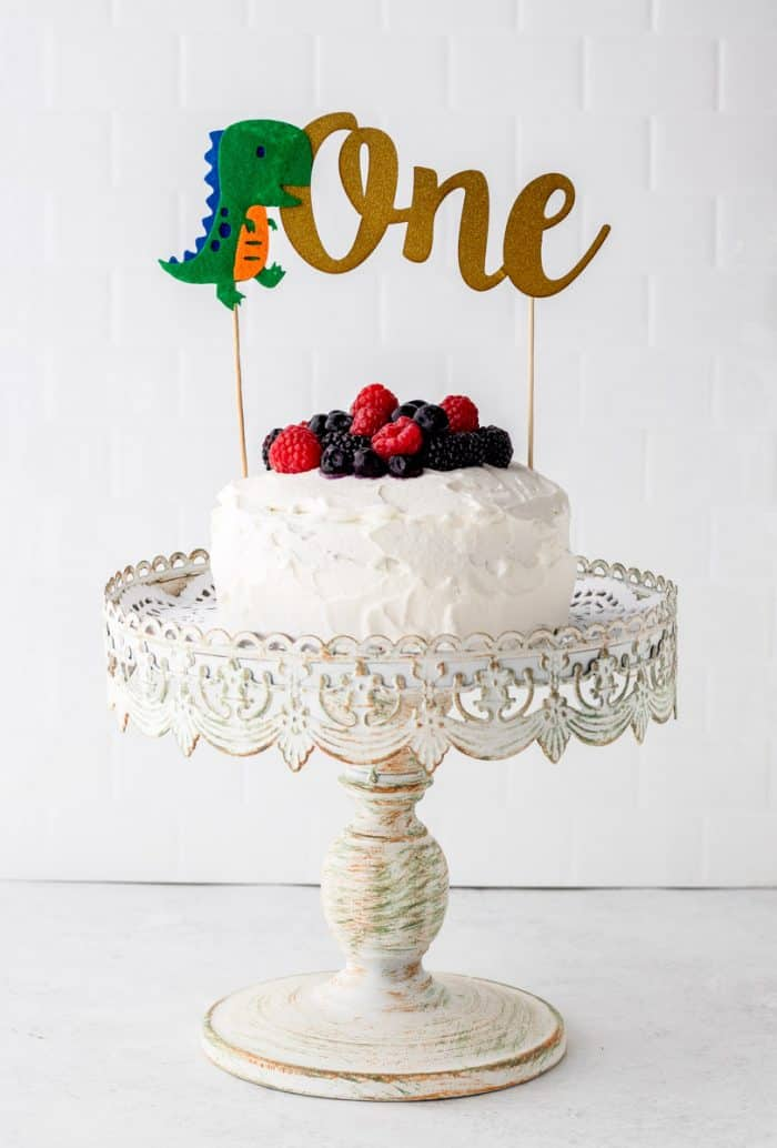 A smash cake with a 'one' banner on top of it.
