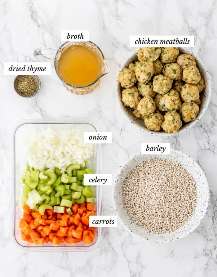 Ingredients for the Italian meatball soup on marble background with labels