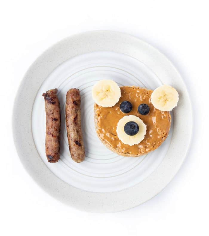 Teddy bear toast on a plate with two turkey sausages