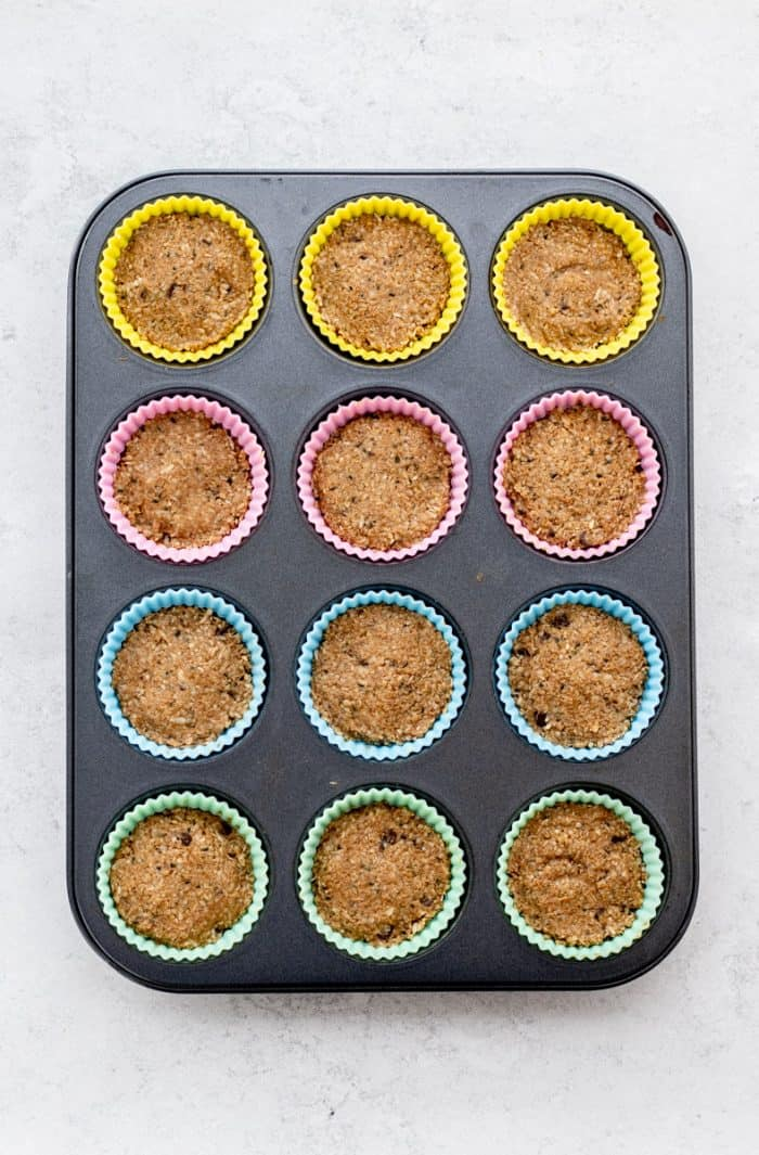 The snack mixture placed into silicone muffin molds.