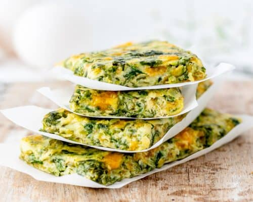 Veggie frittata cut into fingers and stacked on top of each other.