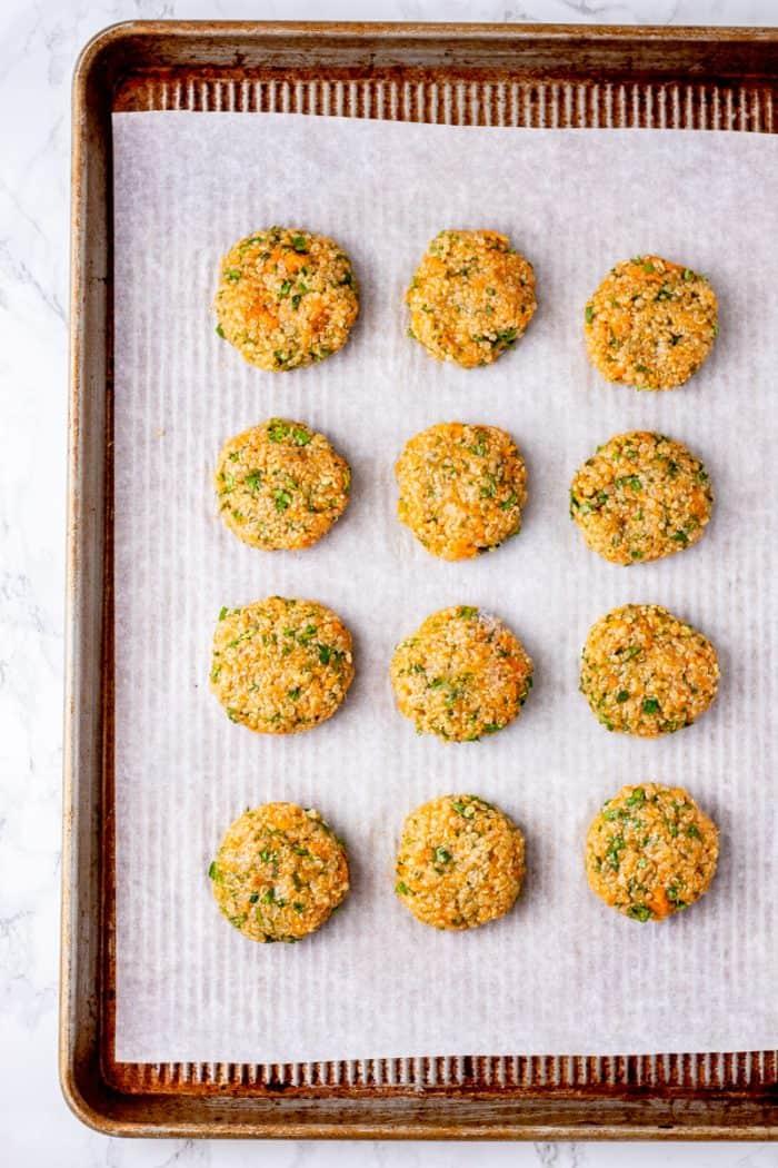 Unbaked quinoa patties on a baking sheet