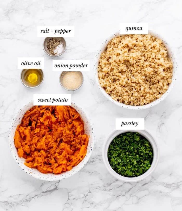 Ingredients for the quinoa cakes recipe on marble background with labels