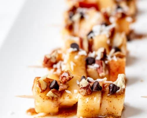Close up of the toppings on the apple skewers.