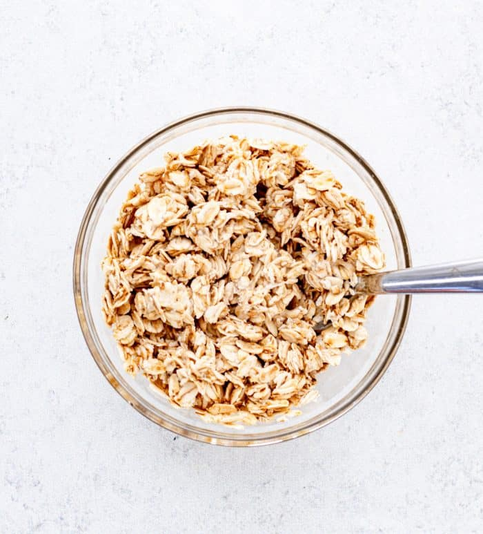 oats and milk in a bowl with a spoon