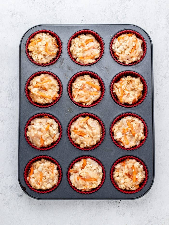 chicken mixture divided into a muffin tin
