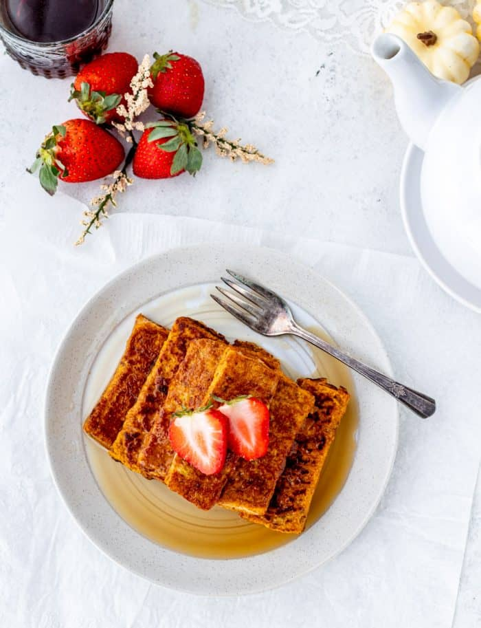 French toast sticks topped with fresh strawberries.