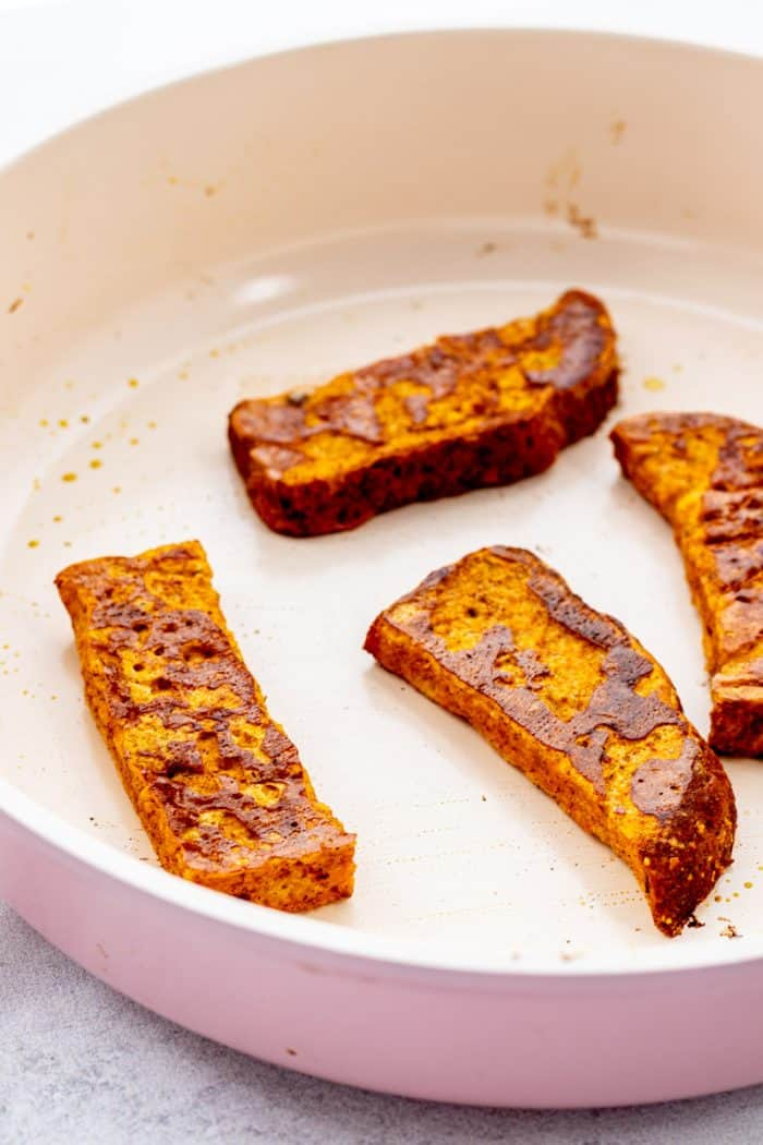 Close up of the pumpkin French toast sticks in a skillet.
