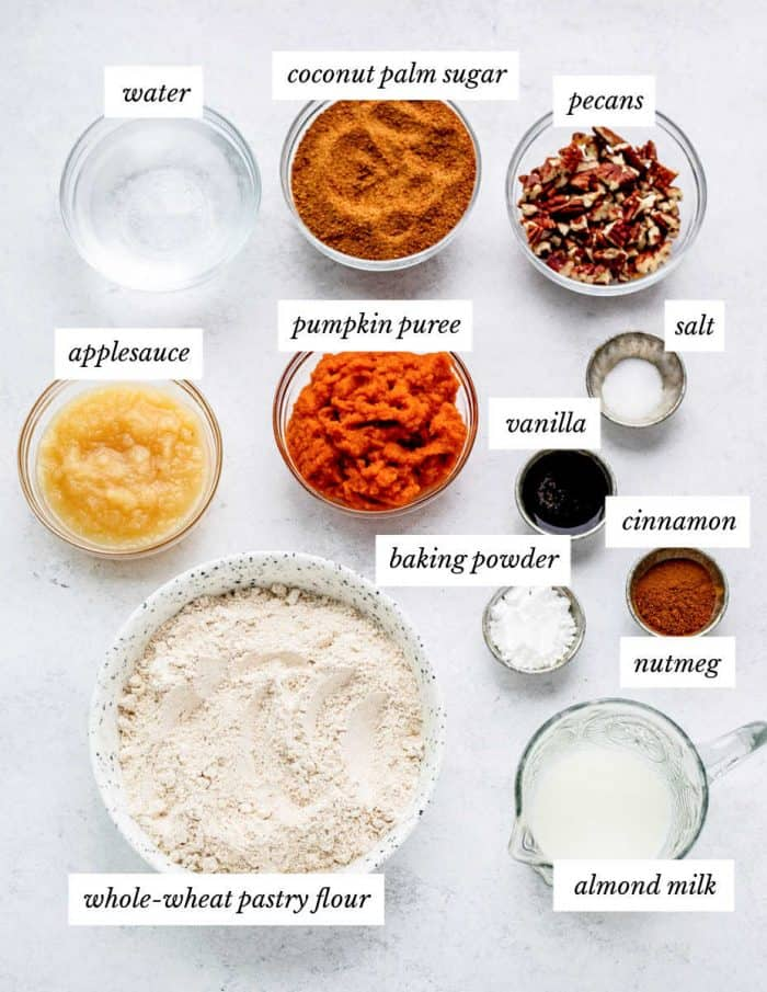 ingredients for the pumpkin cake on a grey background with labels